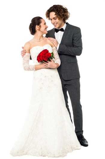 Romantic couple in bridal attire lost in each other