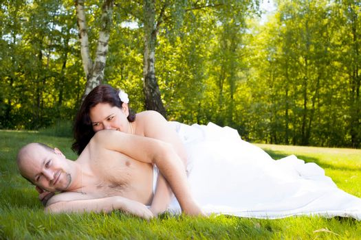 Happy young couple dressed white in the nature
