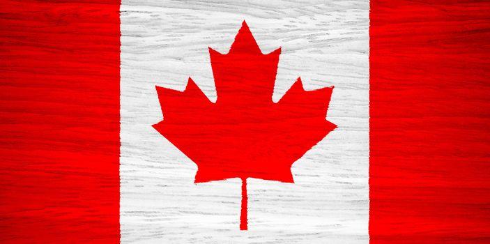 Canada flag on wood texture