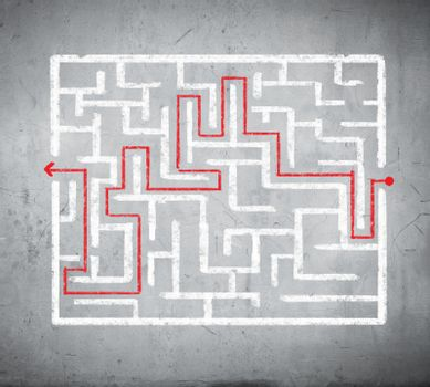 Drawn abstract maze against white background. Finding solution