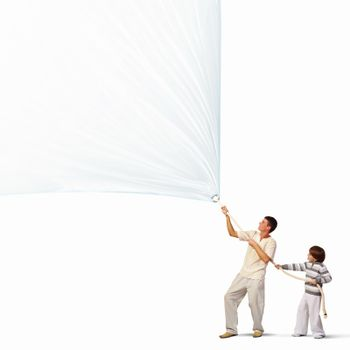 Young happy family pulling blank banner. Place for text