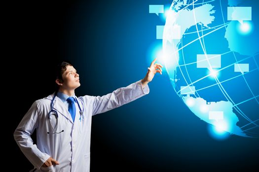 Image of young doctor touching media screen