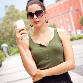 attractive woman with sunglasses in the city summertime portrait lifestyle smiling
