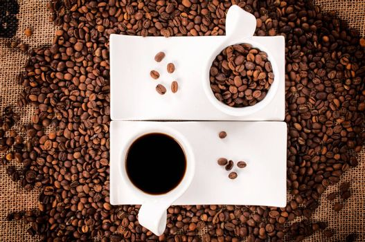 Selective focus on the cups with raw and instant coffee