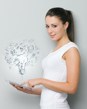 A beautiful young woman working on her digital touchpad