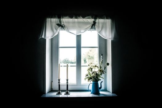 Romantic window with beautiful curtains and decorations
