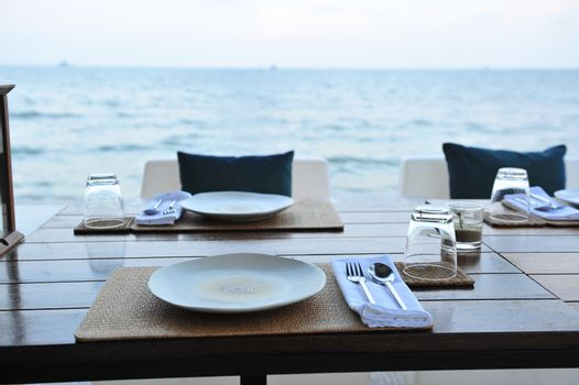 Dining table prepared close to the sea