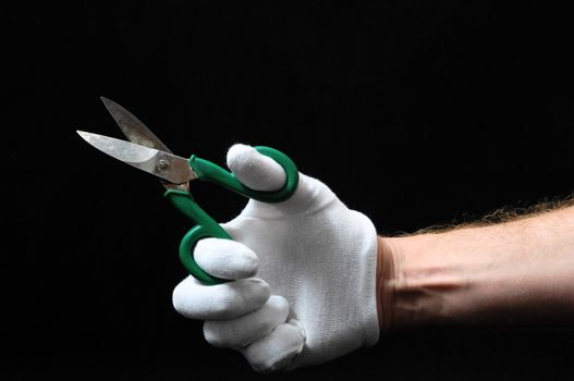 Scissors and Hand on a Black Background