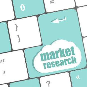 key with market research text on laptop keyboard