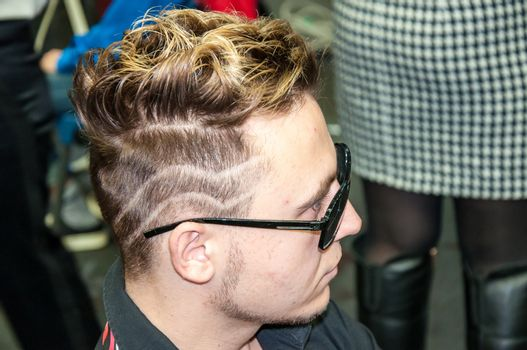 ORENBURG, ORENBURG region, RUSSIA, November 30, 2013 year. The young man participant contest male hairstyles