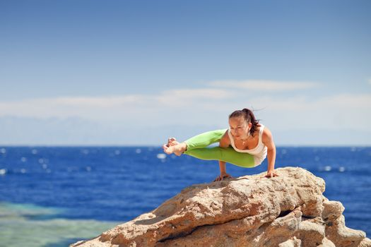 yoga on the mountain by the sea