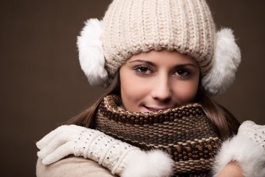 Portrait of a young beautiful woman wearing winter clothes
