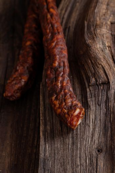 Sausage. Dried Smoked Sausages Sliced on wooden Board. Chorizo sausage