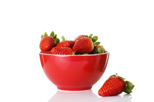 Fresh red strawberries in a bowl. Isolated on white.