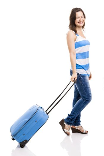 Beautiful young woman carrying her luggage ready for travel, isolated over white background