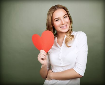 Portrait of happy romantic girl with red paper heart-shaped postcard, romantic wishes, Valentine day celebration, love concept