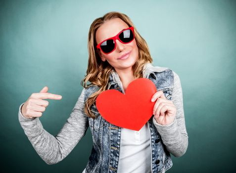Woman with romantic postcard isolated on gray background, showing on red heart-shaped valentines, teens affection concept