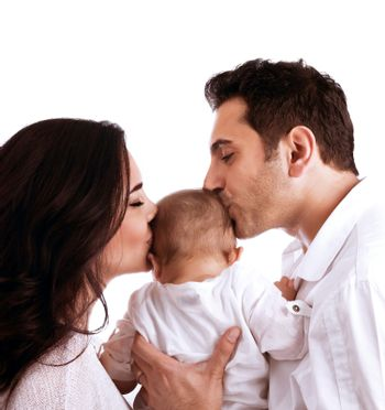 Gentle loving family, young parents kissing sweet little child, isolated on white background, carrying baby, togetherness concept
