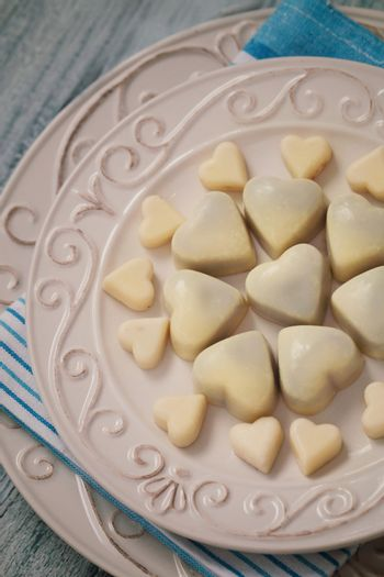 Valentines place setting. White chocolate hearts. Wedding table