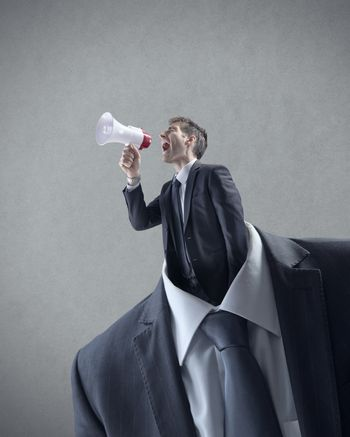 Businessman shouting through megaphone in place of head.