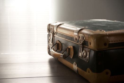 Vintage suitcase on a table, travel concept.