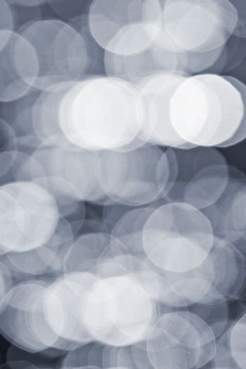 Abstract defocused bokeh grey background of light and shadows