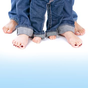 Family generation, abstract border, mom and dad with small kid wearing jeans isolated on white&blue background, body part, barefoot legs, love concept
