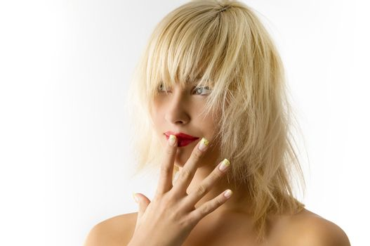 fashion portrait of blond girl with red lips and uncombed hair