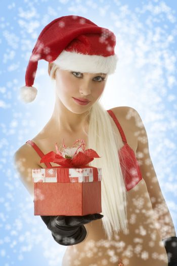 close up of a young beautiful blond santa claus with gift box