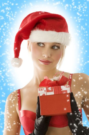 close up of young beautiful blond santa claus with red christmas gift box