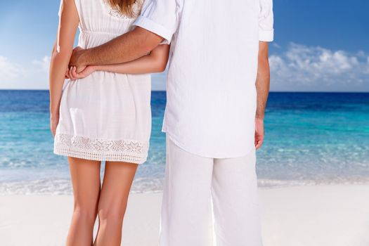 Closeup image of woman and man wearing white clothes enjoying seascape, body part, holding hands, summer vacation in love concept