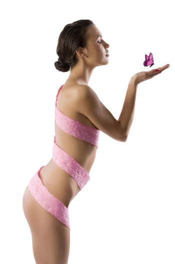 part of naked body of slim woman with some pink scarf of paper around the body
