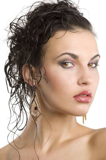 young beautiful brunette woman with hair style and nice jewellery
