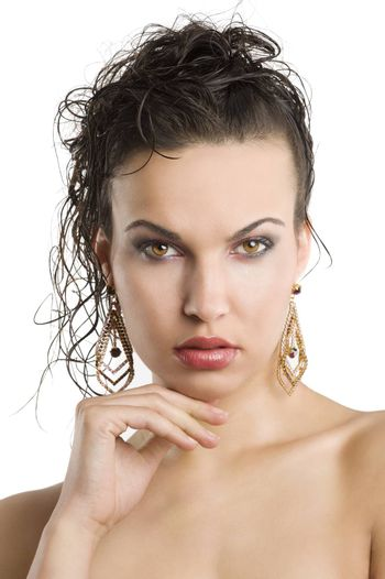 young beautiful brunette woman with hair style and nice jewellery looking in camera