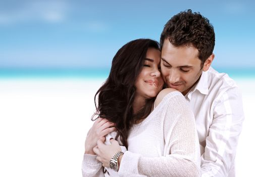 Romantic holidays for two, beautiful loving couple hugging on the beach, just married, summer vacation, love and romance concept