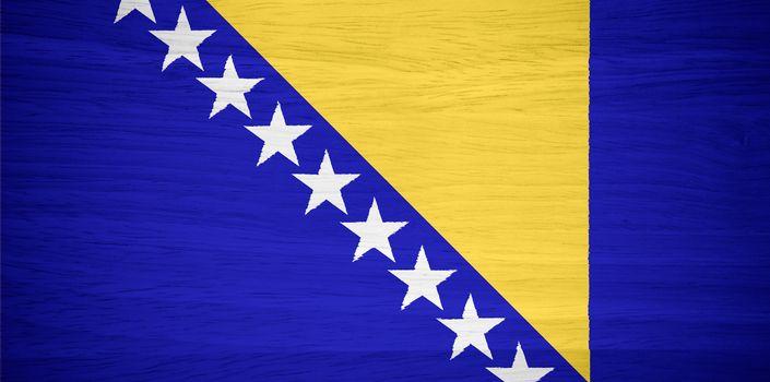 Bosnia and Herzegovina flag on wood texture