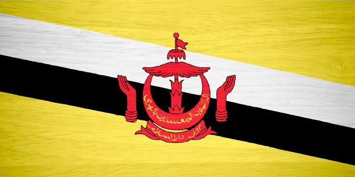 Brunei flag on wood texture