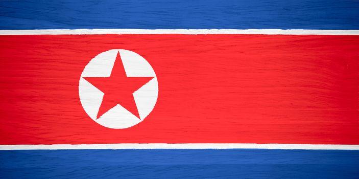 North Korea flag on wood texture
