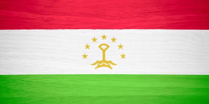 Tajikistan flag on wood texture