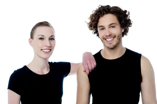 Cheerful young couple posing isolated on white