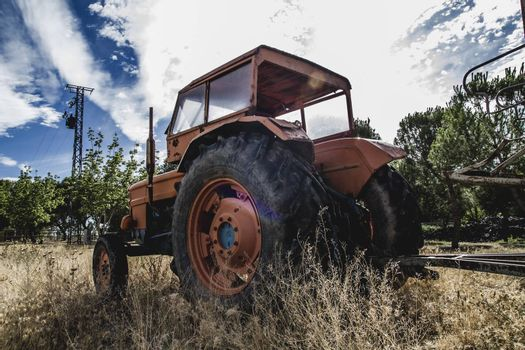 vehicle, old agricultural tractor abandoned in a farm field
