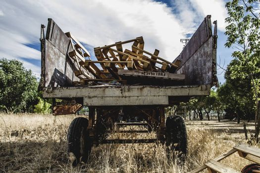 machinery, old agricultural tractor abandoned in a farm field