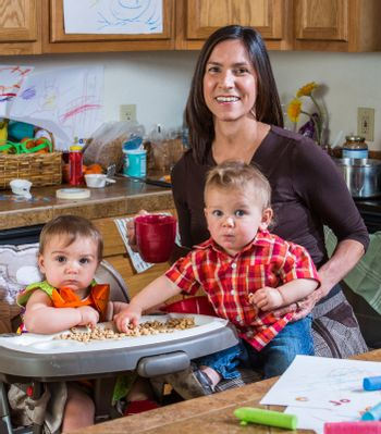 Mother poses with children in the kitchen