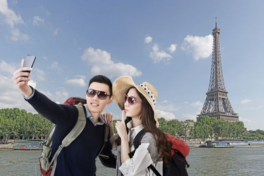 Asian couple travel and selfie in Paris, France.