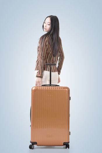 Modern Asian woman stand with a luggage.