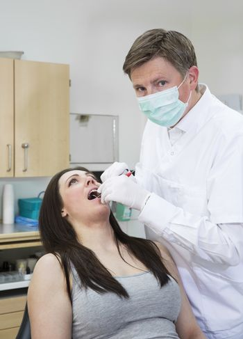 Male Dentist and female patient situation