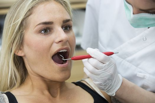 Close up of a woman at the dentist