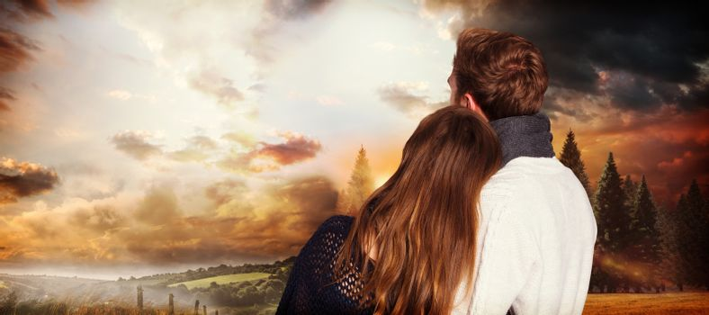 Close up rear view of romantic couple against country scene