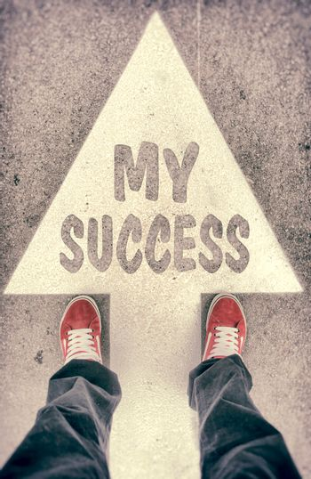 Brand new red shoes from above standing on my success sign