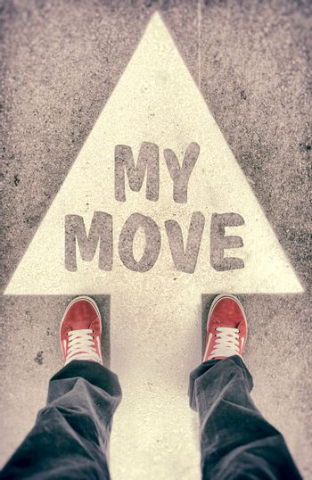 Brand new red shoes from above standing on my move sign